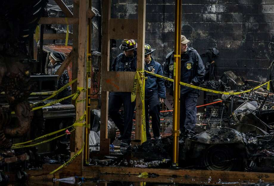 ATF police and Oakland fire officials inspect the Ghost Ship warehouse on Dec. 10. All 36 victims conclusively died of smoke inhalation, a coroner's deputy said Friday. Photo: Santiago Mejia, The Chronicle