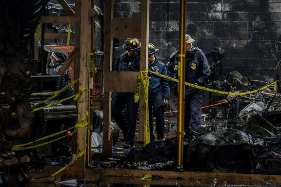 ATF police and Oakland fire officials inspect the Ghost Ship warehouse on Saturday, Dec. 10, 2016 in Oakland, Calif. 36 people were killed when a fire broke out on Dec. 2 at the Ghost Ship warehouse on 31st Avenue and International Boulevard in Oakland's Fruitvale neighborhood. As many as 100 people were inside attending a music performance. The blaze is now the deadliest structure fire in California since the 1906 earthquake and fire. Officials said the cause of ignition is still unknown and the building had no evidence of fire sprinklers.