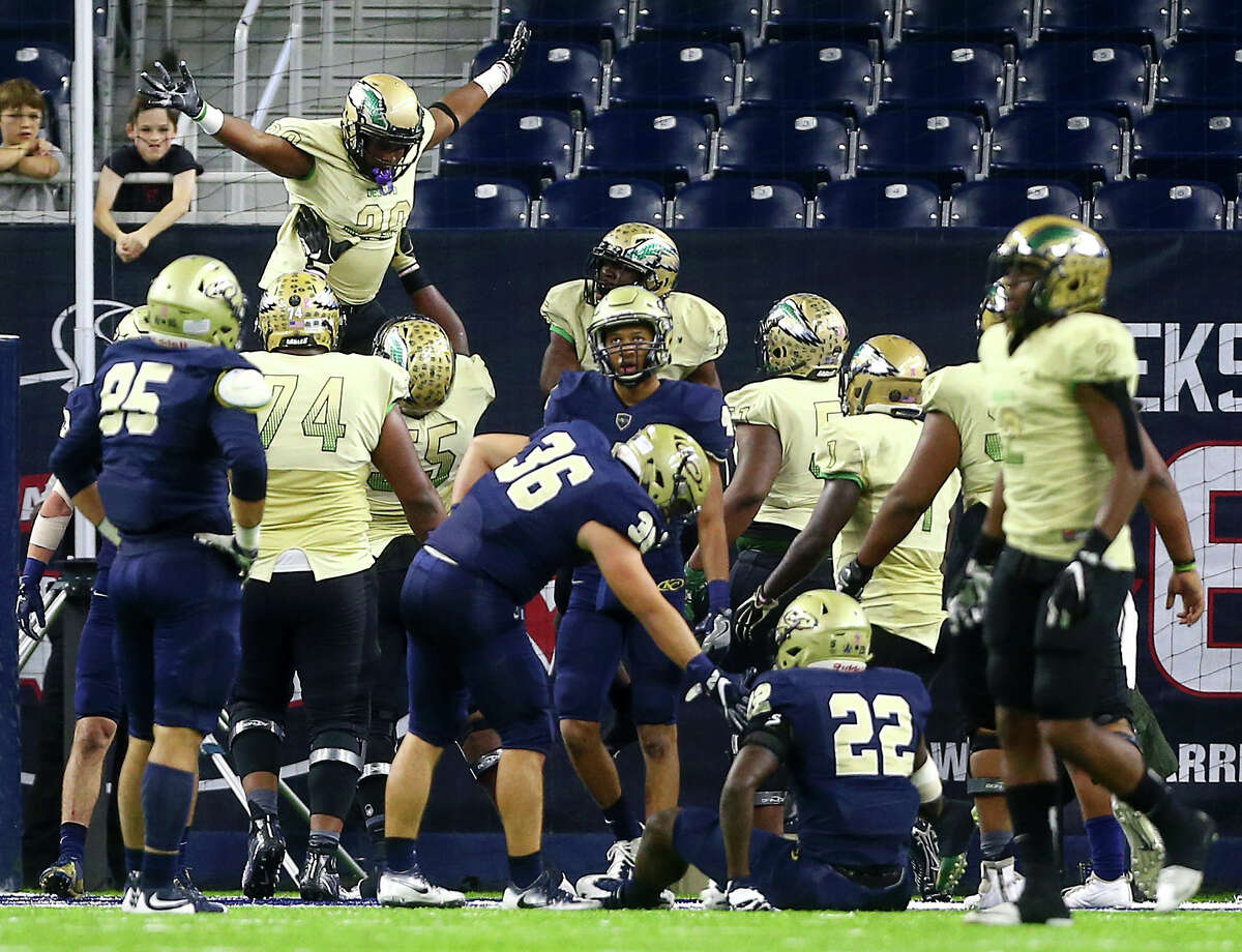 DeSoto running back Rickie Washington, II, (28) is lifted by teammates after rushing for a touchdown during the fourth quarter of the Class 6A, Division II state semifinals, at NRG Stadium, Saturday, Dec. 10, 2016, in Houston.