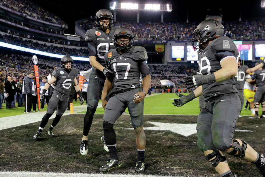 Army quarterback Ahmad Bradshaw (17) celebrates his touchdown with teammates in the second half of the Army-Navy NCAA college football game in Baltimore, Saturday, Dec. 10, 2016. Army won 21-17. (AP Photo/Patrick Semansky) ORG XMIT: MDPS124 Photo: Patrick Semansky / Copyright 2016 The Associated Press. All rights reserved.