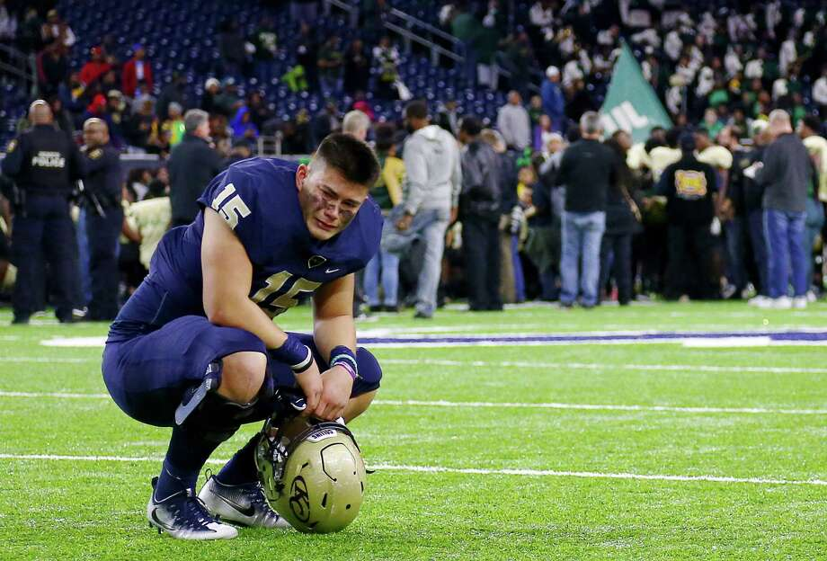 Klein Collins defensive lineman Tyler Spillman (15) is emotional on the field after a loss to DeSoto in the Class 6A, Division II state semifinals, at NRG Stadium, Saturday, Dec. 10, 2016, in Houston. Photo: Jon Shapley, Houston Chronicle / © 2015  Houston Chronicle