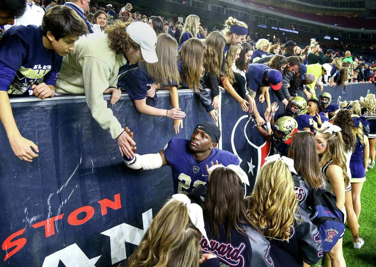 Klein Collins linebacker Donavan Mutin (22) gives high-fives to fans with tears rolling down his cheeks after losing to DeSoto in the Class 6A, Division II state semifinals, at NRG Stadium, Saturday, Dec. 10, 2016, in Houston.