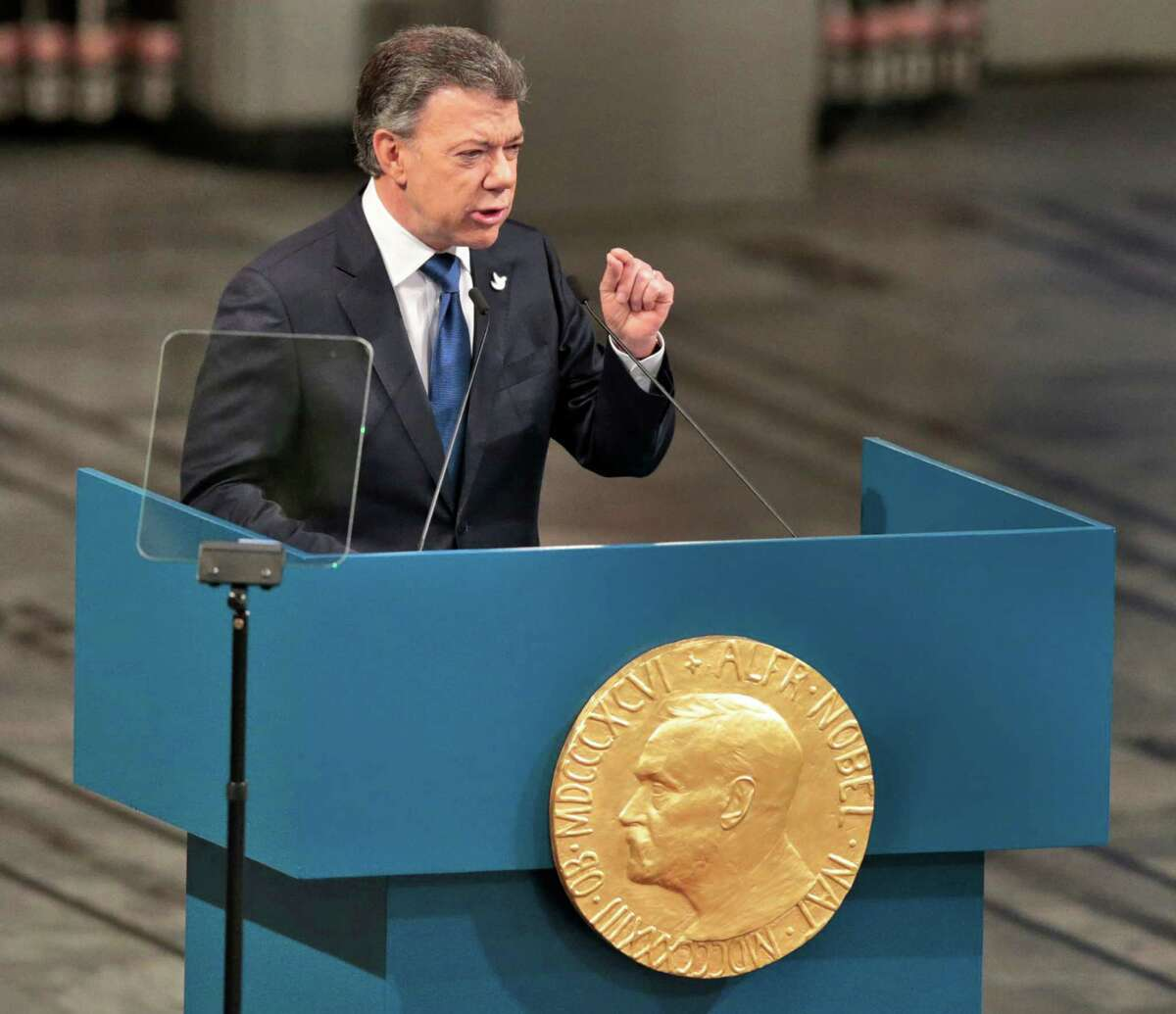 Nobel Peace Prize Laureate Colombian President Juan Manuel Santos gives a speech during the Peace Prize awarding ceremony at the City Hall in Oslo, Saturday Dec. 10, 2016. President Juan Manuel Santos are awarded this year's Nobel Peace Prize for his efforts to bring Colombia's more than 50-year-long civil war to an end. (Lise Aaserud / NTB scanpix via AP)