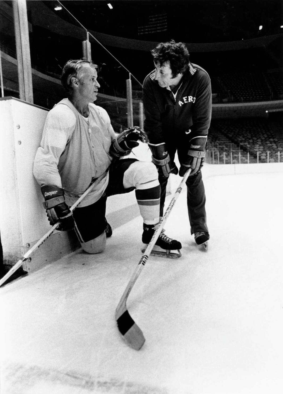 Bill Dineen, right, coached Gordie Howe and the Houston Aeros for six seasons, winning two Avco Cups and twice earning WHA coach-of-the-year honors.
