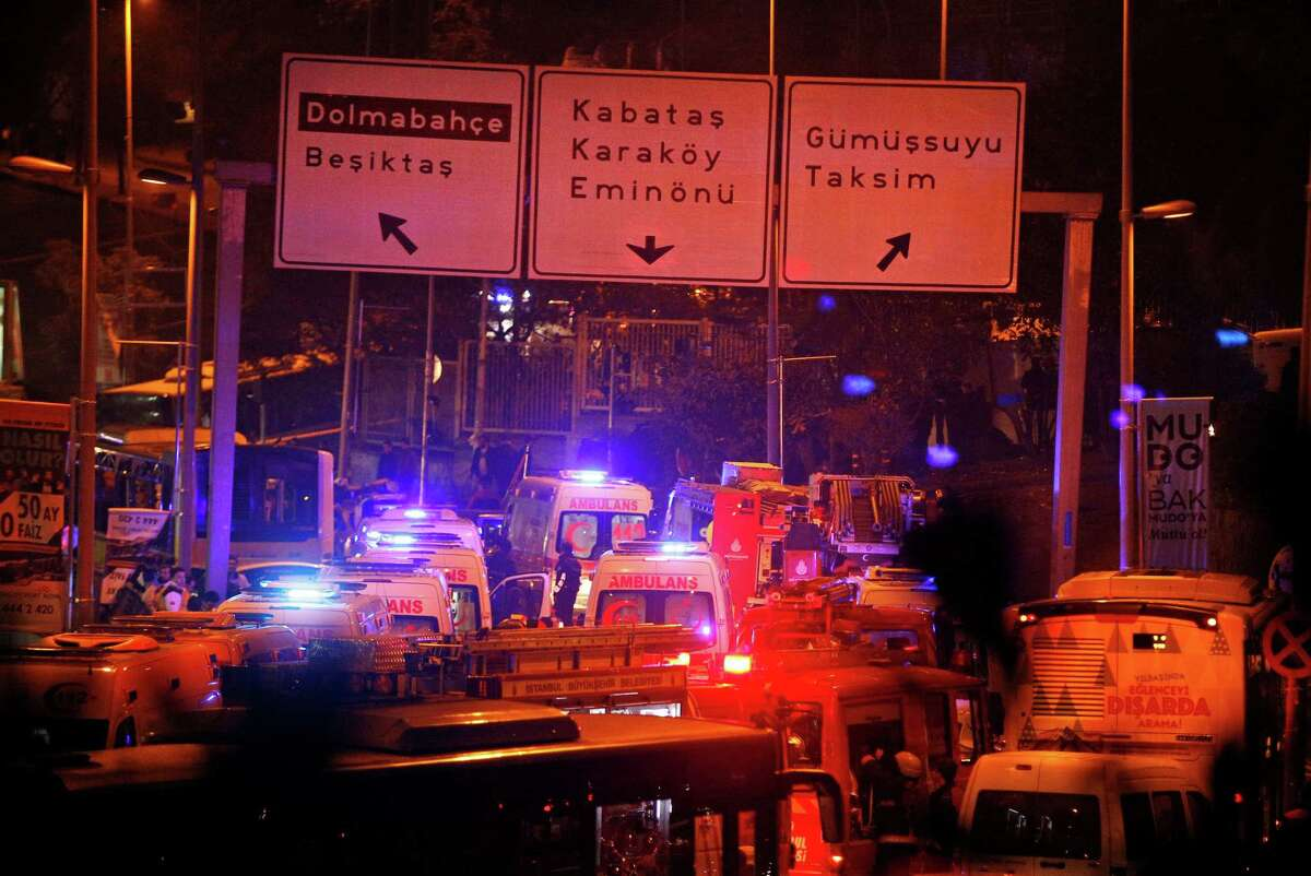 Rescue vehicles rush to the scene of explosions near the Besiktas soccer stadium following an attack in Istanbul late Saturday. Authorities have banned distribution of images relating to the Istanbul explosions within Turkey.