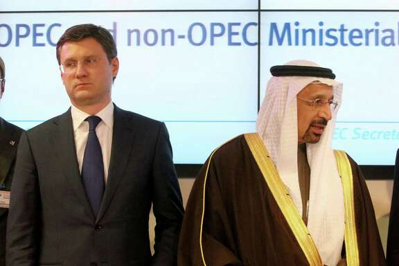 Russian Minister of Energy Alexander Novak, left, and Khalid Al-Falih, minister of Energy, Industry and Mineral Resources of Saudi Arabia, finish a news conference after a meeting of OPEC member countries at their headquarters in Vienna, Austria.