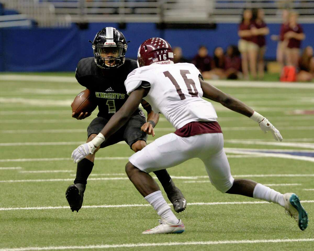 Josh Ofili (16) of Cinco Ranch prepares to tackle Xavier Martin (1) of Cibolo Steele in the first half of the Conference 6A Division II State Semi-Final playoff game between the Cinco Ranch Cougars and the Cibolo Steele Knights on Saturday December 10, 2016 at the Alamodome, San Antonio, TX.