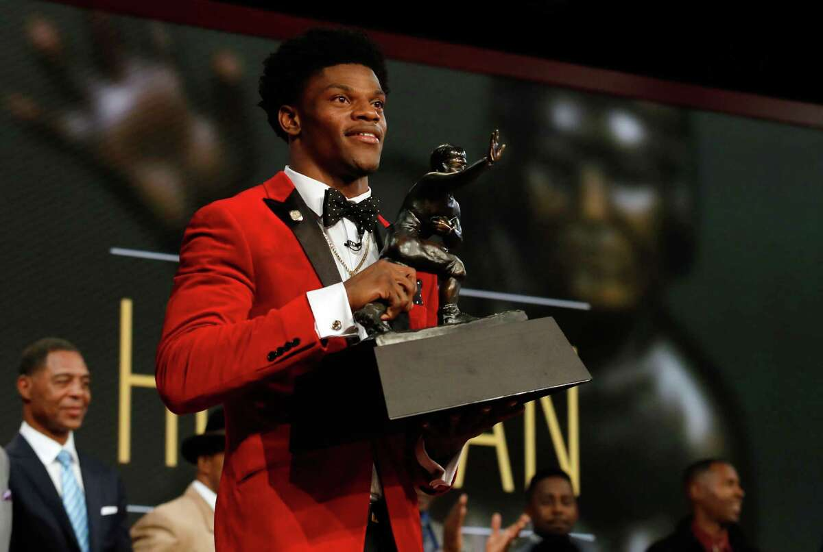 NEW YORK, NY - DECEMBER 10: Quarterback Lamar Jackson of the Louisville Cardinals poses with the trophy after being named the 82nd Heisman Memorial Trophy Award winner during the 2016 Heisman Trophy Presentation at the Best Buy Theater on December 10, 2016 in New York City.