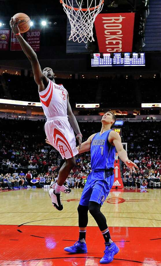 Houston Rockets forward Montrezl Harrell, left, shoots past Dallas Mavericks forward Dwight Powell (7) during the first half of an NBA basketball game, Saturday, Dec. 10, 2016, in Houston. (AP Photo/Eric Christian Smith) Photo: Eric Christian Smith, Associated Press / FR171023 AP