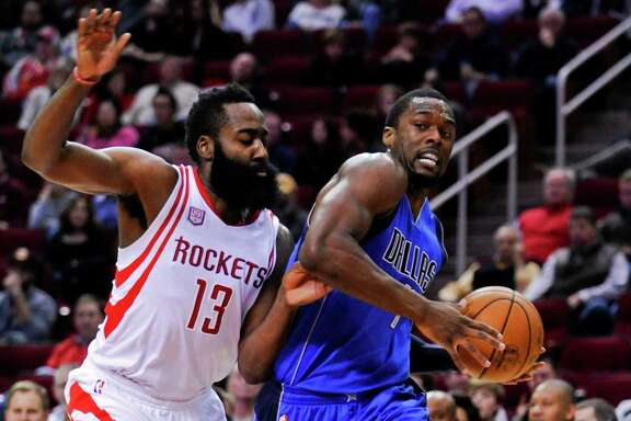 Dallas Mavericks forward Harrison Barnes, right, drives past Houston Rockets guard James Harden (13) during the first half of an NBA basketball game, Saturday, Dec. 10, 2016, in Houston. (AP Photo/Eric Christian Smith)