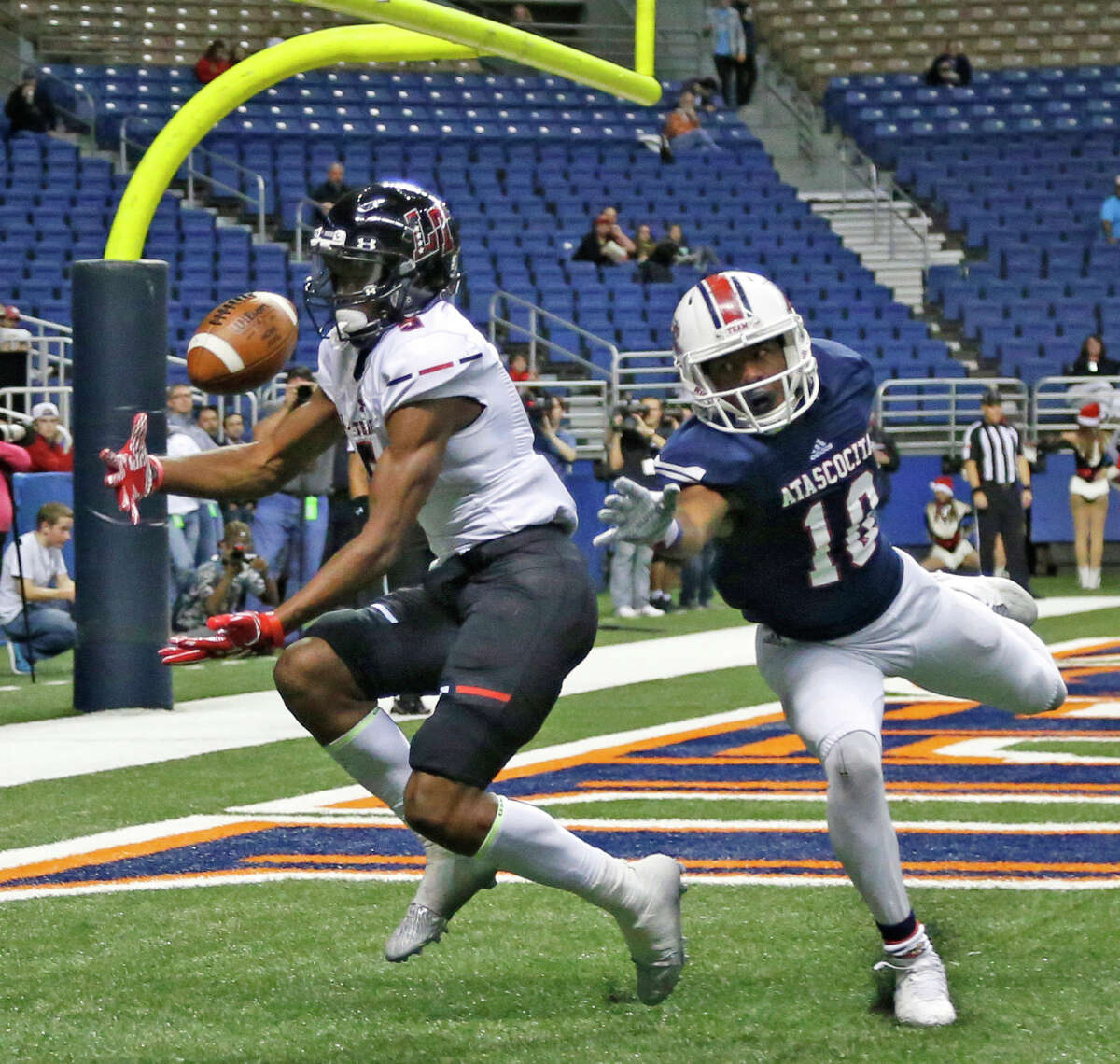 Lake Travis' Garrett Wilson hauls in a touchdown pass in front of Atascocita's Justen Campbell, giving the Cavaliers a 35-7 lead just before halftime Saturday.