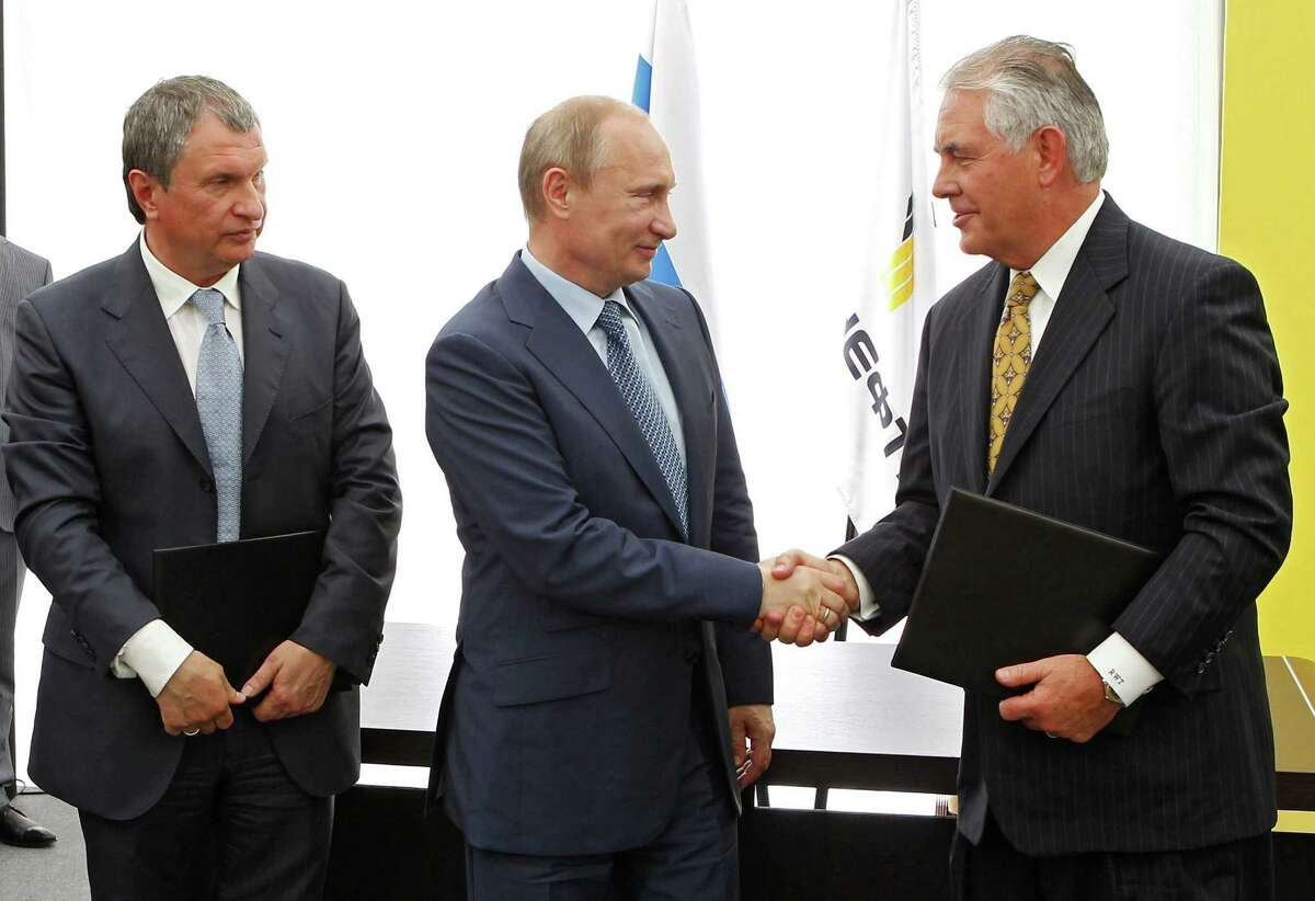 Russian President Vladimir Putin, left, and Exxon Mobil CEO Rex Tillerson have known each other for over 20 years through oil and gas dealings.