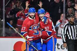 MONTREAL, QC - DECEMBER 10:  Max Pacioretty #67 of the Montreal Canadiens celebrates his hat-trick goal with teammate Alexander Radulov #47 during the NHL game against the Colorado Avalanche at the Bell Centre on December 10, 2016 in Montreal, Quebec, Canada.  (Photo by Minas Panagiotakis/Getty Images)