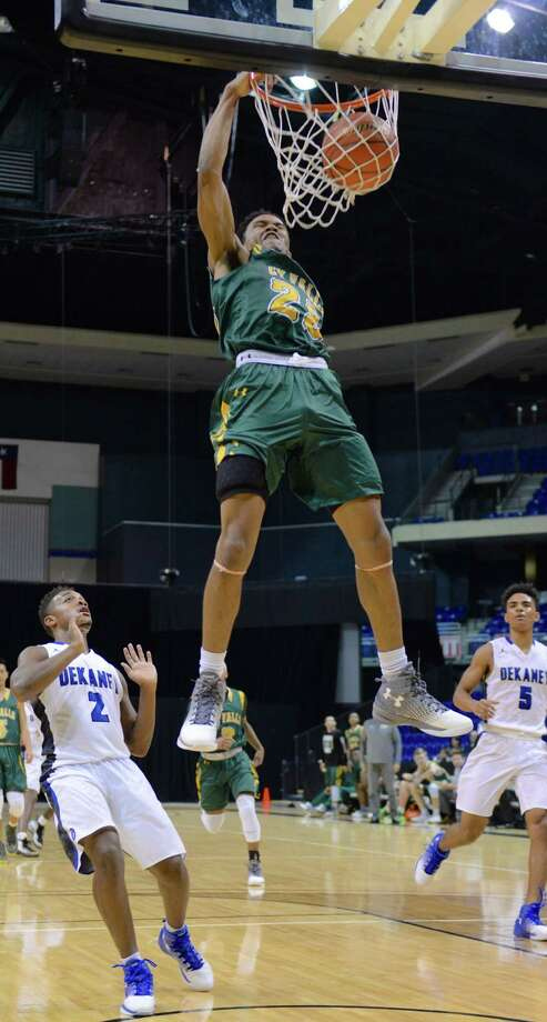 Cy Falls junior guard Nigel Hawkins throws it down in the Cy Hoops Invitational Finals against Dekaney. Dekaney would prevail 53-50, but Hawkins finished with a game-high 23 points in the loss. Photo: Joel Weckerly, CFISD