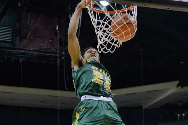 Cy Falls junior guard Nigel Hawkins throws it down in the Cy Hoops Invitational Finals against Dekaney. Dekaney would prevail 53-50, but Hawkins finished with a game-high 23 points in the loss.