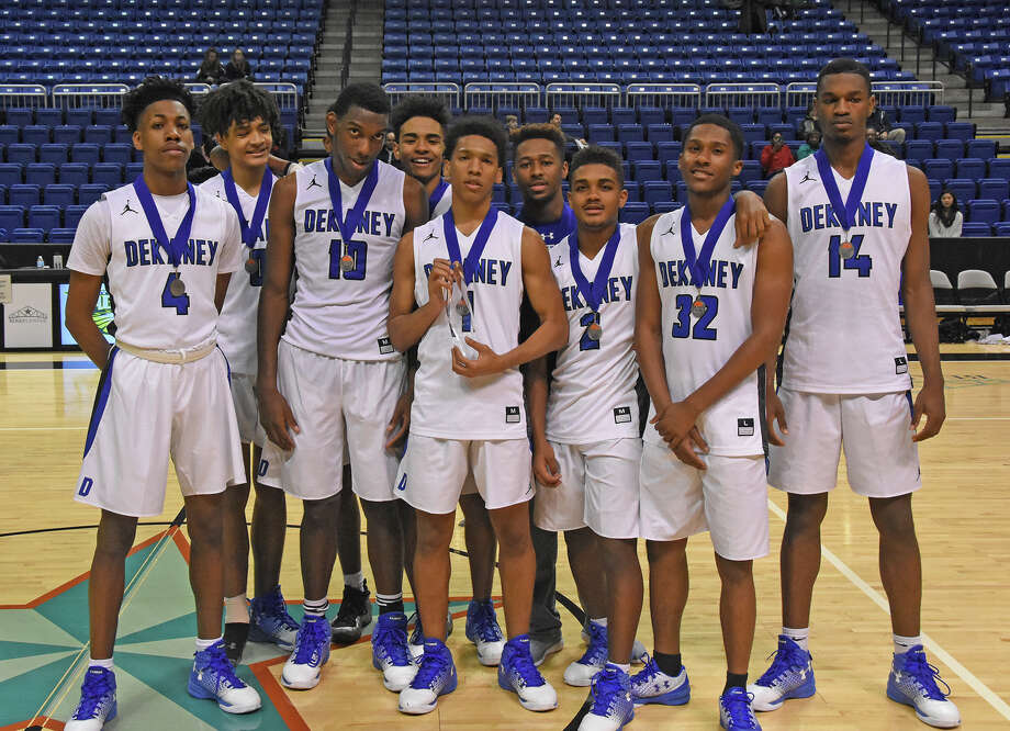 The Dekaney Wildcats were the Cy Hoops Invitational champions Saturday at the Berry Center, defeating Cy Falls 53-50 to earn first-place honors. Senior guard Cameron Ivey (1) was named Tournament MVP. Photo: Joel Weckerly, CFISD