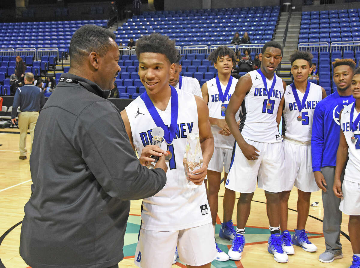 Dekaney senior guard Cameon Ivey accepts his Tournament MVP trophy after Saturday's 53-50 win against Cy Falls. Dekaney head coach David Peavy said that Ivey is one of the most underrated, under recruited players in the city of Houston.