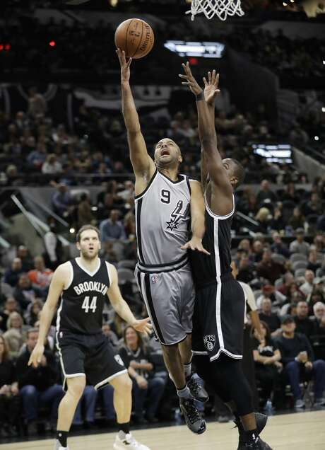 San Antonio Spurs guard Tony Parker (9) shoots past Brooklyn Nets guard Isaiah Whitehead, right, during the first half of an NBA basketball game, Saturday, Dec. 10, 2016, in San Antonio. (AP Photo/Eric Gay) Photo: Eric Gay/Associated Press
