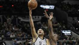 San Antonio Spurs guard Tony Parker (9) shoots past Brooklyn Nets guard Isaiah Whitehead, right, during the first half of an NBA basketball game, Saturday, Dec. 10, 2016, in San Antonio. (AP Photo/Eric Gay)