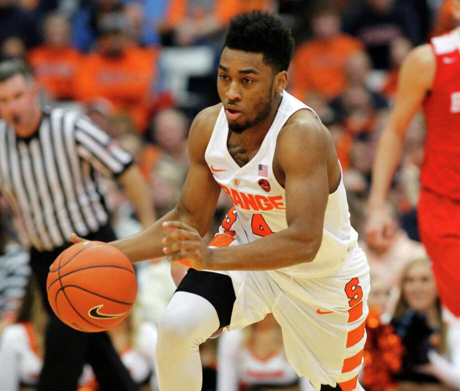 Syracuse's John Gillon dribbles to the basket in the second half of an NCAA college basketball game against Boston University in Syracuse, N.Y., Saturday, Dec. 10, 2016. Syracuse won 99-77. (AP Photo/Nick Lisi) ORG XMIT: NYNL114 Photo: Nick Lisi / FR171024 AP