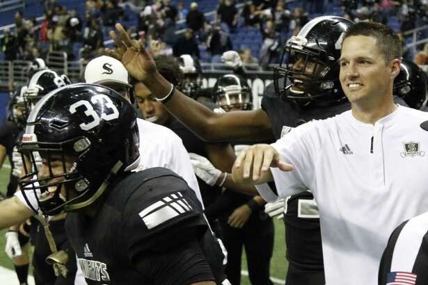 Steele coach Scott Lenhoff celebrates with the team during the Class 6A Division II state semifinal against Katy Cinco Ranch at the Alamodome on Dec. 10, 2016.