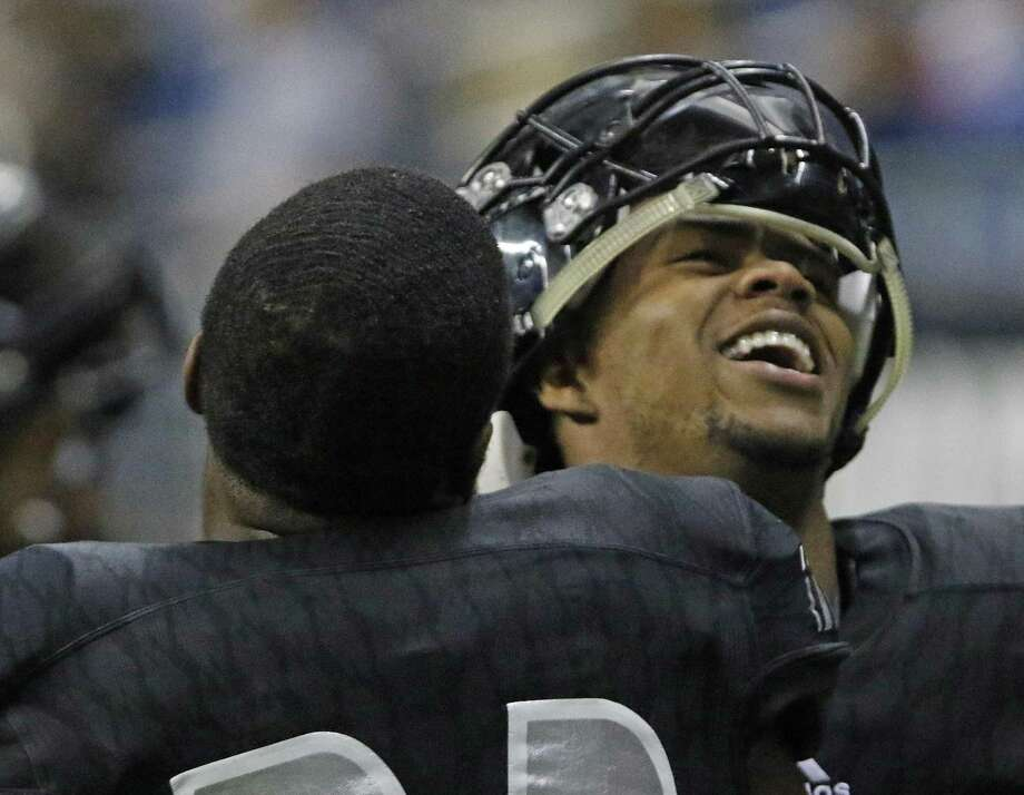 Steele's Xavier Martin celebrates with jacy Ivory from the Class 6A Division II state semifinal high school football game between Steele and Katy Cinco Ranch at the Alamodome on Saturday , December 10, 2016. Photo: Ron Cortes, Freelance / For The San Antonio Express-News / Ronald Cortes / Freelance