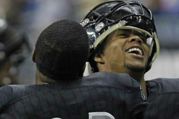 Steele's Xavier Martin celebrates with jacy Ivory from the Class 6A Division II state semifinal high school football game between Steele and Katy Cinco Ranch at the Alamodome on Saturday , December 10, 2016.