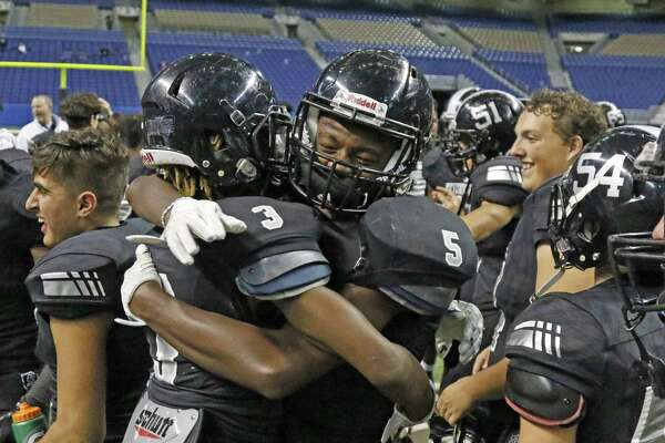 Steele's players celebrate at the end of the game from the Class 6A Division II state semifinal high school football game between Steele and Katy Cinco Ranch at the Alamodome on Saturday , December 10, 2016.