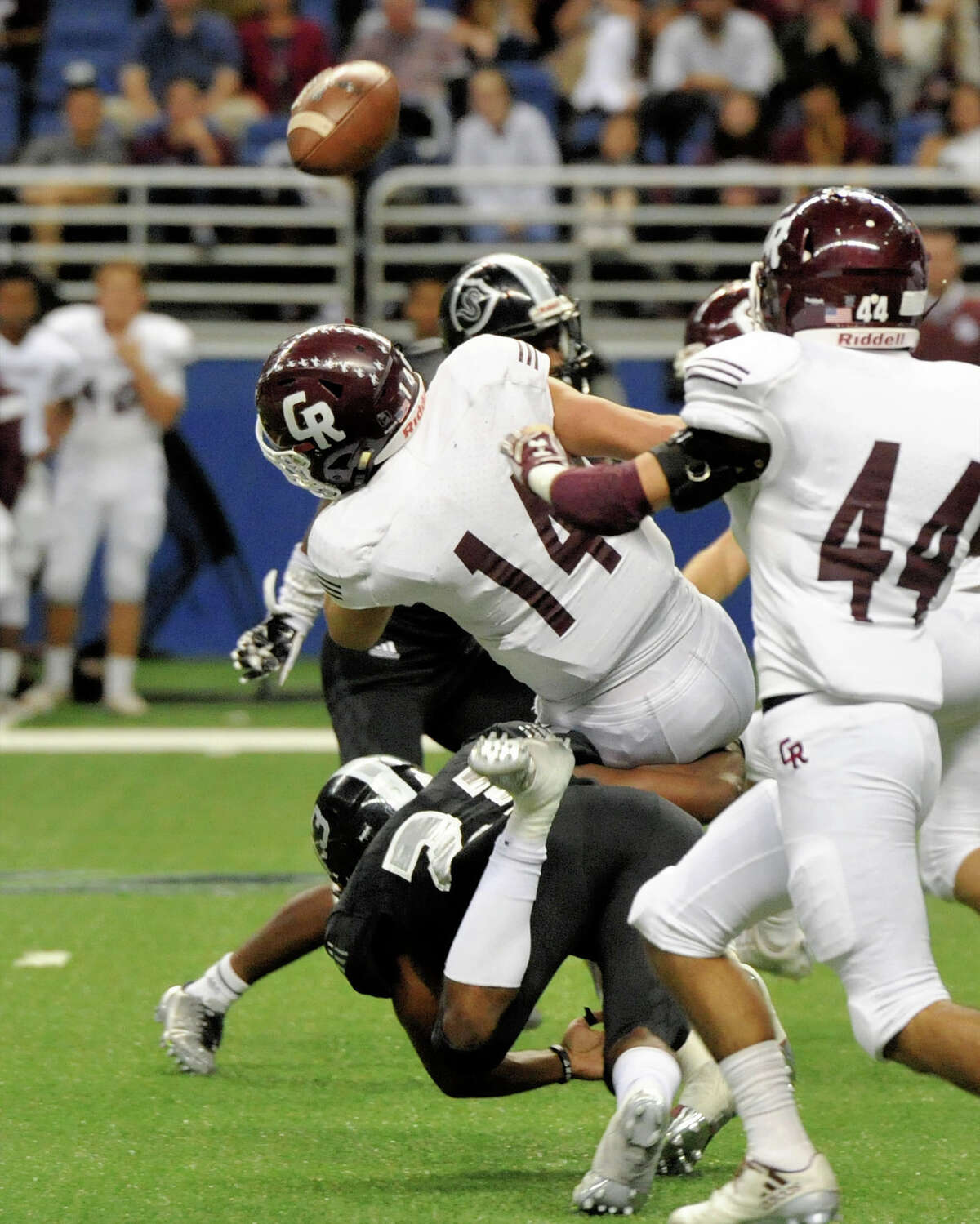 Cinco Ranch's Brant Kuithe (14) fumbles on a kickoff return in the first half to set up a short touchdown drive for Cibolo Steele on Saturday at the Alamodome.