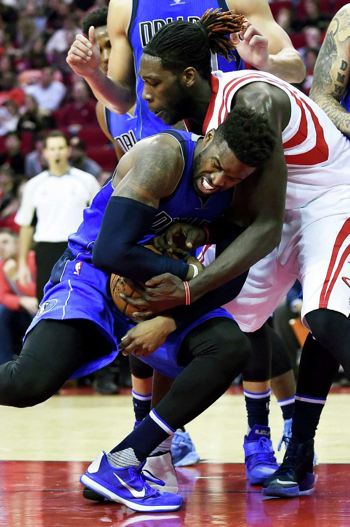 Dallas Mavericks guard Wesley Matthews, bottom, and Houston Rockets forward Montrezl Harrell (5) fight for a loose ball during the second half of an NBA basketball game, Saturday, Dec. 10, 2016, in Houston. Houston won 109-87. (AP Photo/Eric Christian Smith)