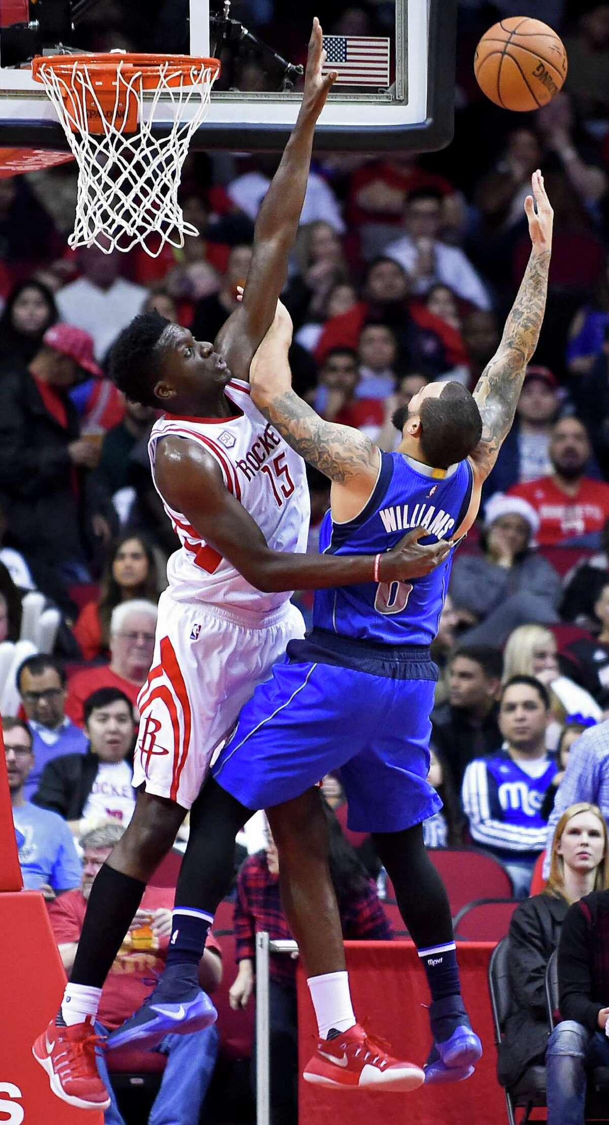 Dallas Mavericks guard Deron Williams, right, and Houston Rockets center Clint Capela fight for a rebound during the second half of an NBA basketball game, Saturday, Dec. 10, 2016, in Houston. Houston won 109-87. (AP Photo/Eric Christian Smith)