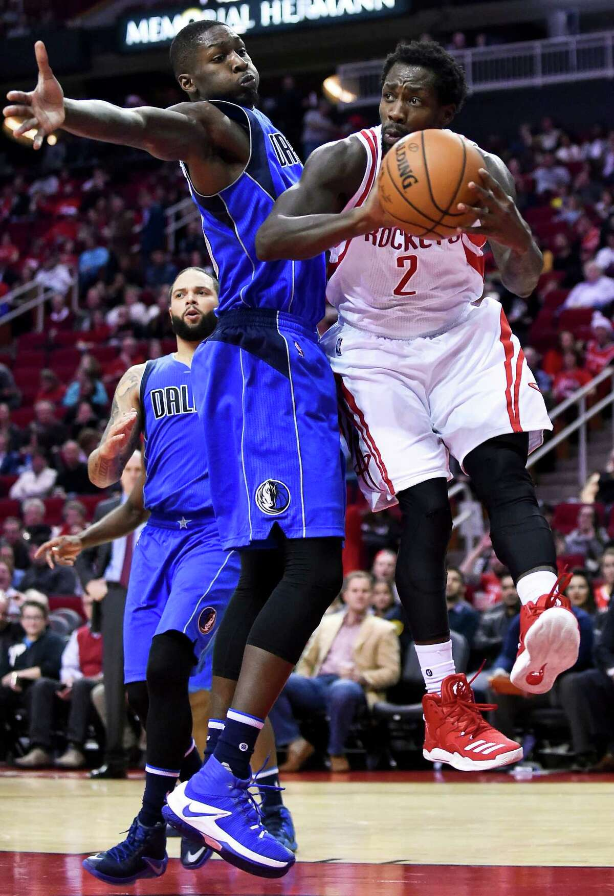 Houston Rockets guard Patrick Beverley (2) looks to pass as Dallas Mavericks forward Dorian Finney-Smith (10) defends during the second half of an NBA basketball game, Saturday, Dec. 10, 2016, in Houston. Houston won 109-87. (AP Photo/Eric Christian Smith)