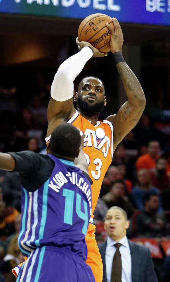 Cleveland Cavaliers' LeBron James (23) shoots over Charlotte Hornets' Michael Kidd-Gilchrist during the first half of an NBA basketball game Saturday, Dec 10, 2016, in Cleveland. (AP Photo/Ron Schwane) ORG XMIT: OHRS102 Photo: Ron Schwane / AP 2016