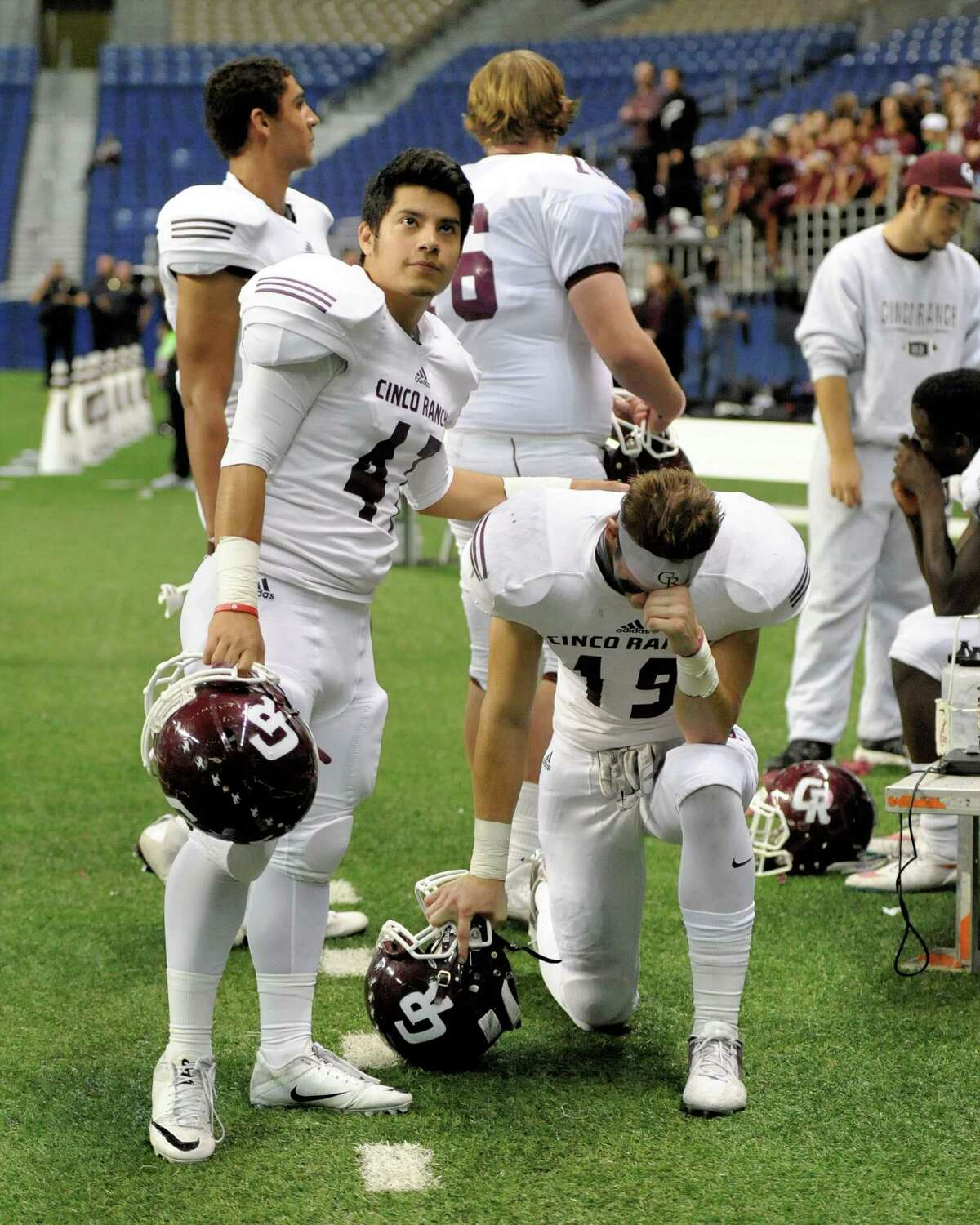Dec. 10: Cibolo Steele 35, Cinco Ranch 14 Julian Davila (47) of Cinco Ranch consoles Blake Gordon (19) after the Conference 6A Division II State Semi-Final playoff game between the Cinco Ranch Cougars and the Cibolo Steele Knights on Saturday December 10, 2016 at the Alamodome, San Antonio, TX.