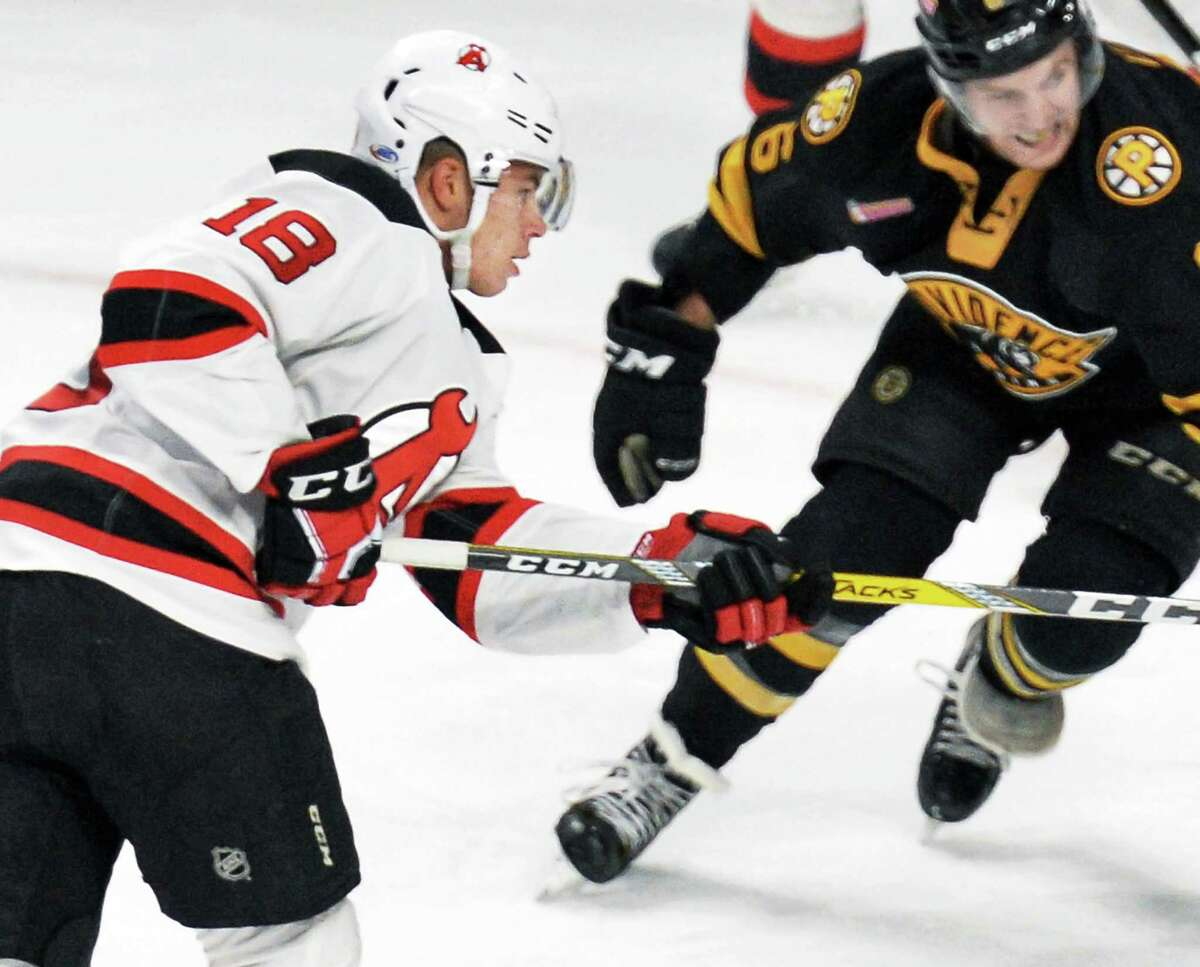 Albany Devils' #18 Blake Pietila's , left, shot scores against the Providence Bruins during Saturday's game at the Times Union Center Dec. 10, 2016 in Albany, NY. (John Carl D'Annibale / Times Union)