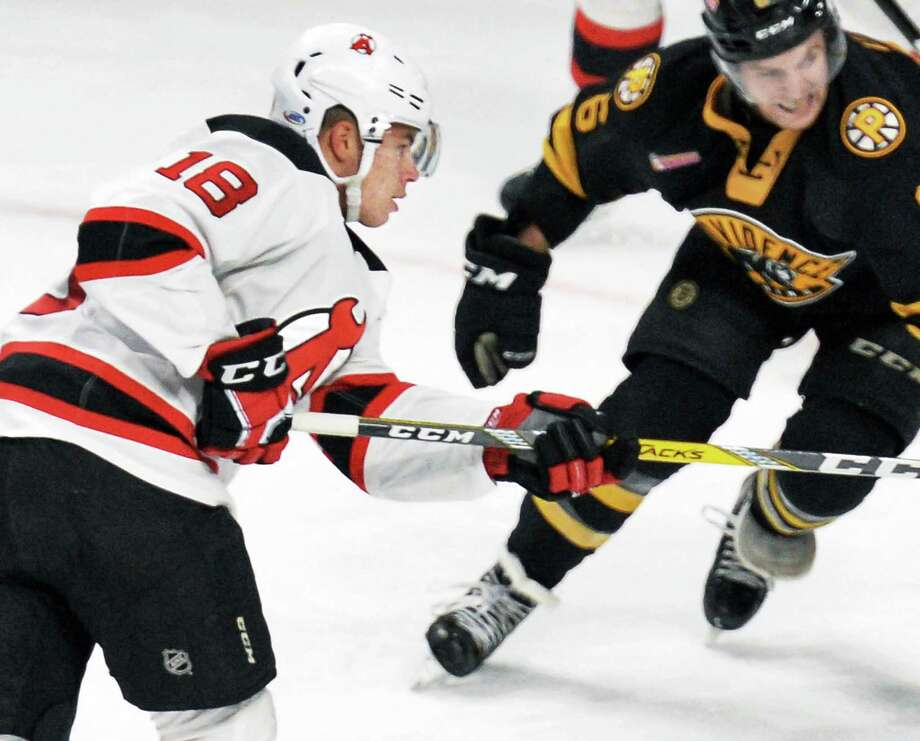 Albany Devils' #18 Blake Pietila's , left, shot scores against the Providence Bruins during Saturday's game at the Times Union Center Dec. 10, 2016 in Albany, NY.  (John Carl D'Annibale / Times Union) Photo: John Carl D'Annibale / 20038436A