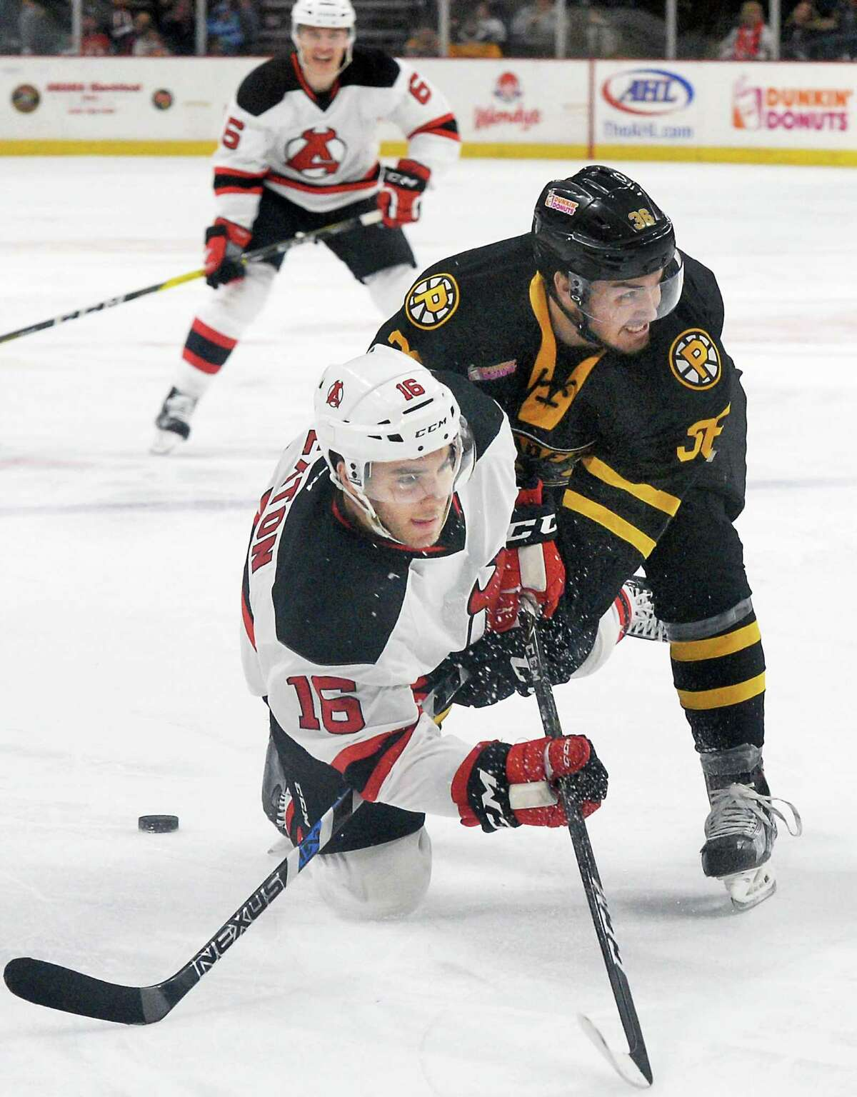 Albany Devils' #16 Ben Sexton, left, and Providence Bruins' #36 Zac Rinaldo tangle during Saturday's game at the Times Union Center Dec. 10, 2016 in Albany, NY. (John Carl D'Annibale / Times Union)