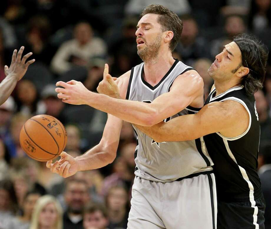 Spurs' Pau Gasol is fouled by Brooklyn Nets' Luis Scola during first half action on Dec. 10, 2016 at the AT&T Center. Photo: Edward A. Ornelas /San Antonio Express-News / © 2016 San Antonio Express-News