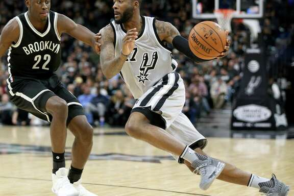 Spurs shooting guard Jonathon Simmons drives around Brooklyn's Caris LeVert on  Dec. 10.