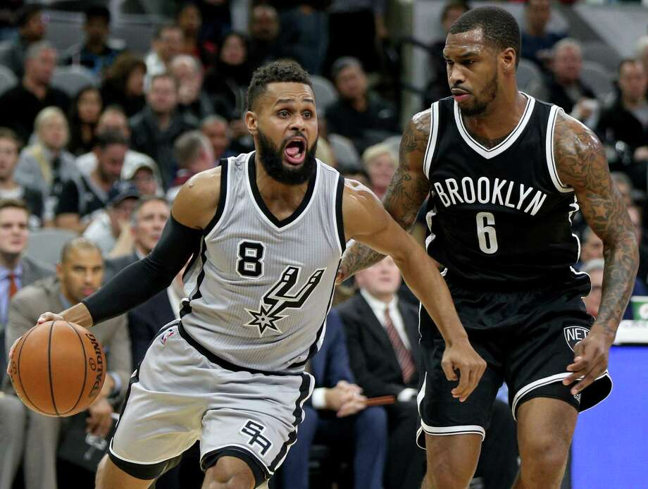 Spurs' Patty Mills drives around Brooklyn Nets' Sean Kilpatrick during second half action on Dec. 10, 2016 at the AT&T Center. Photo: Edward A. Ornelas /San Antonio Express-News / © 2016 San Antonio Express-News