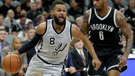 San Antonio Spurs' Patty Mills drives around Brooklyn Nets' Sean Kilpatrick during second half action Saturday Dec. 10, 2016 at the AT&T Center. The Spurs won 130-101.