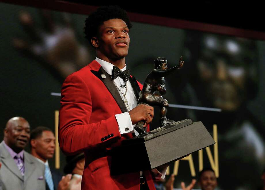 Louisville's Lamar Jackson holds up the Heisman Trophy after winning the Heisman Trophy award Saturday, Dec. 10, 2016, in New York. (Todd Van Emst/Heisman Trophy Trust via AP, Pool) ORG XMIT: NYJJ109 Photo: Todd Van Emst / Copyright 2016 The Associated Press. All rights reserved.
