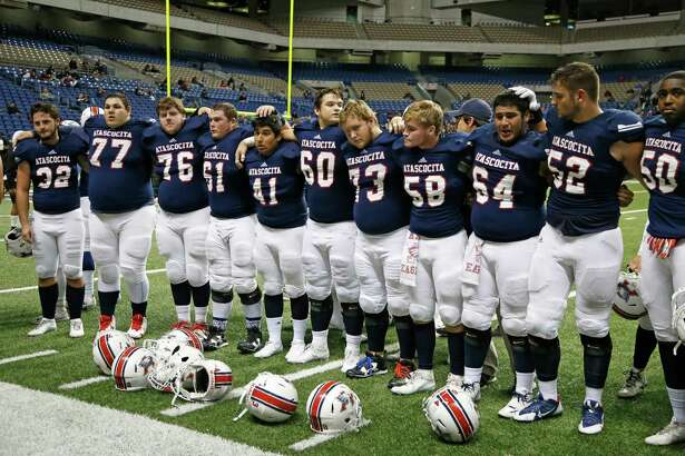 Atascocita stand together at the end of the game from the Class 6A Division I state semifinal high school football game between Lake Travis and Atascocita at the Alamodome on Saturday , December 10, 2016.