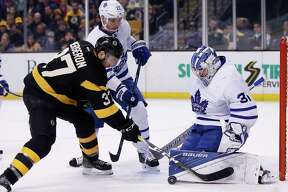 Toronto Maple Leafs' Frederik Andersen (31), of Denmark, blocks a shot by Boston Bruins' Patrice Bergeron (37) during the second period of an NHL hockey game in Boston, Saturday, Dec. 10, 2016. (AP Photo/Michael Dwyer) ORG XMIT: MAMD109
