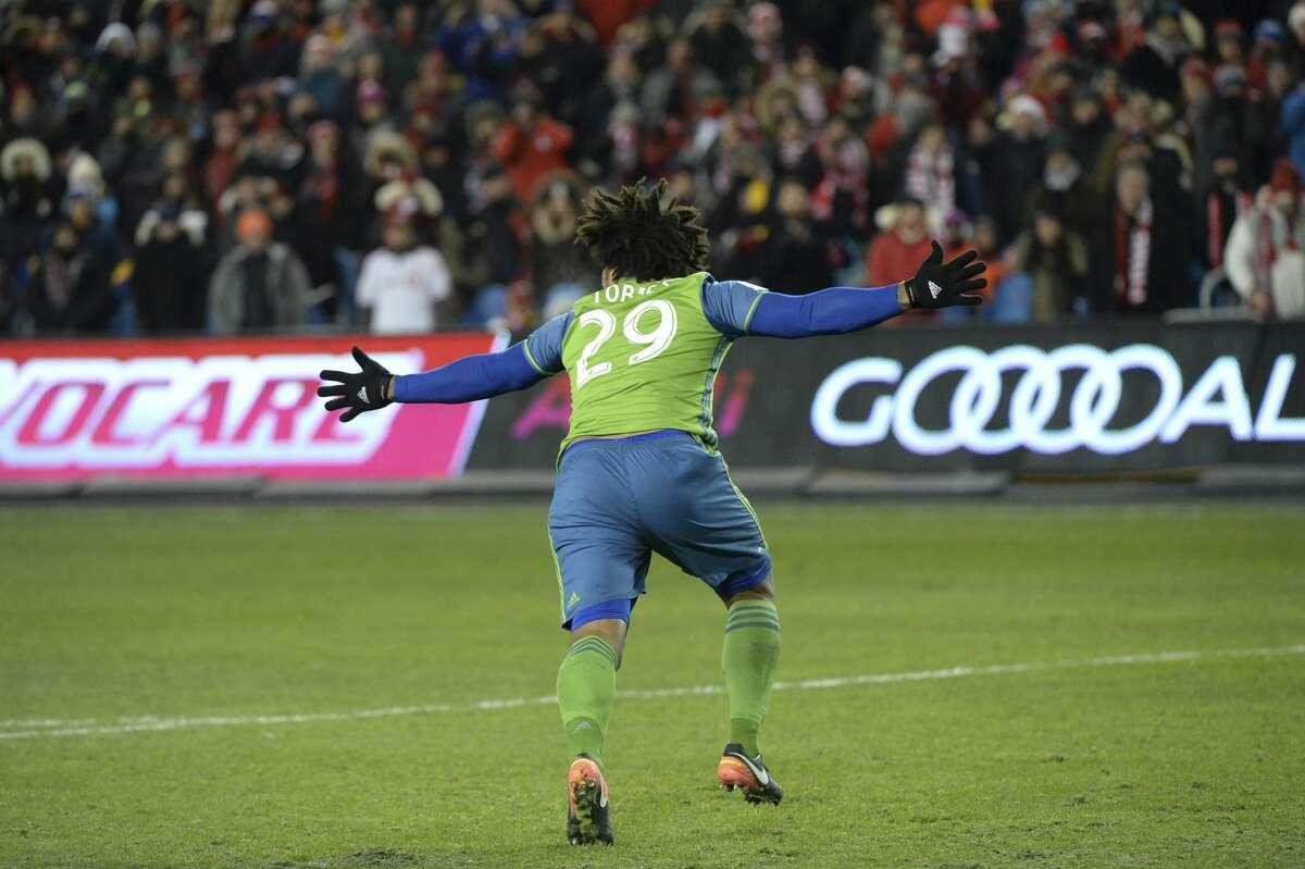 Seattle Sounders defender Roman Torres (29) celebrates his winning goal during penalty kicks.