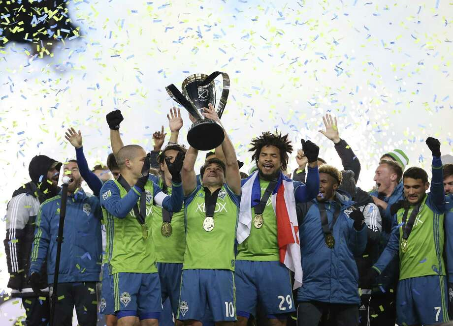 Seattle Sounders celebrate their MLS Cup final victory over Toronto FC at BMO Field on December 10, 2016 in Toronto. / AFP PHOTO / Cole BurstonCOLE BURSTON/AFP/Getty Images Photo: COLE BURSTON, AFP/Getty Images / AFP or licensors