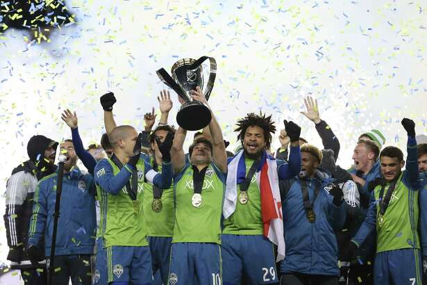 Seattle Sounders celebrate their MLS Cup final victory over Toronto FC at BMO Field on December 10, 2016 in Toronto. / AFP PHOTO / Cole BurstonCOLE BURSTON/AFP/Getty Images