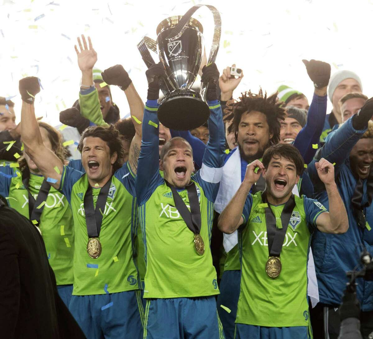 Seattle Sounders players celebrate after winning the MLS Cup soccer final against Toronto FC in Toronto, Saturday, Dec. 10, 2016. (Nathan Denette/The Canadian Press via AP)