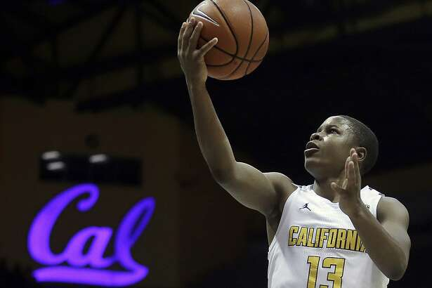 California's Charlie Moore lays up a shot against UC Davis in the first half of an NCAA college basketball game Saturday, Dec. 10, 2016, in Berkeley, Calif. (AP Photo/Ben Margot)