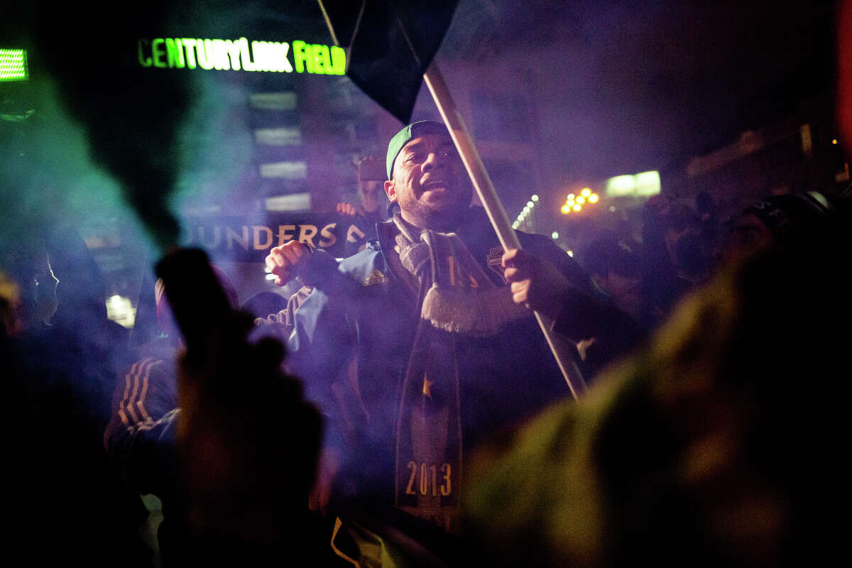 Seattle Sounders fans celebrate at CenturyLink Field following Seattle's win over Toronto FC in the MLS Cup in Toronto, on Saturday, Dec. 10, 2016.